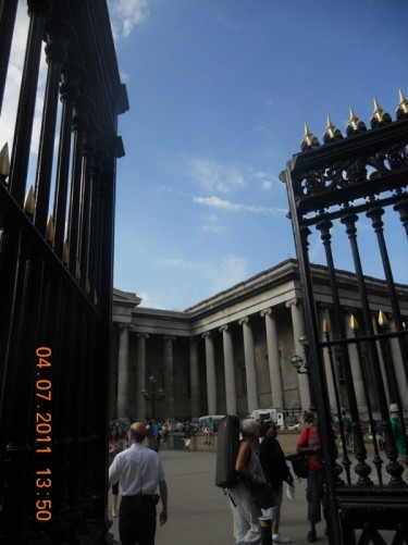 The large ornamental iron railings and gates at the main entrance to the British Museum.