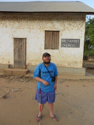 Tony outside the Methodist Church, Janjanbureh, Gambia. The church dates from 1835 and is the oldest Methodist church in Sub-Saharan Africa.