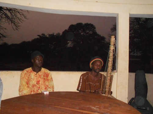 A man playing a kora (West African harp). Simon's house, Abene.