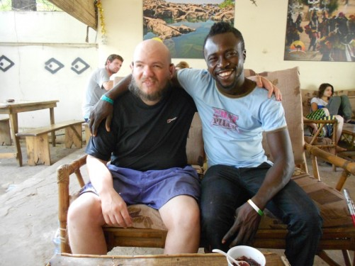 Tony sitting with a local guy at the guesthouse.