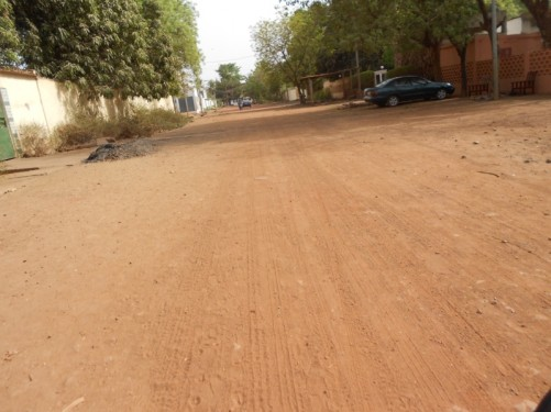 Heading along an unpaved dirt road on south side of the river, near the Sleeping Camel Guesthouse. Residential area.