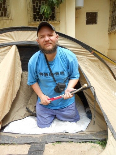 Tony emerging from his 'golden tent'. Sleeping at The Sleeping Camel Guesthouse, Bamako, Mali.