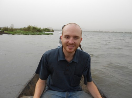 Photo of Phil, from the USA, sitting towards the back of the canoe. A traveller who Tony met on the internet. He lives in Bamako.