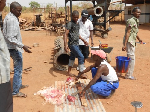 A man butchering some lamb meat.