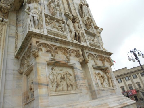 Marble statues, reliefs and other exterior decoration near the cathedral's doorway.