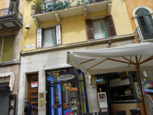 Shops on Via Cappello. A narrow pedestrian street.