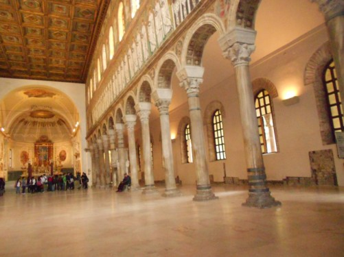 Inside the Basilica of Sant'Apollinare Nuovo, looking along the nave towards the altar. The basilica dates back to the 6th century.