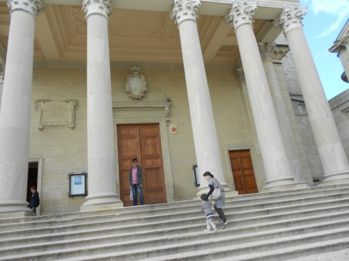 The front of the basilica. Steps lead up to the entrance porch, supported by eight tall stone columns.