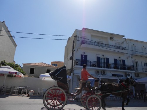 A horse and cart passing by on the road. They offer excursions around the town to tourists.