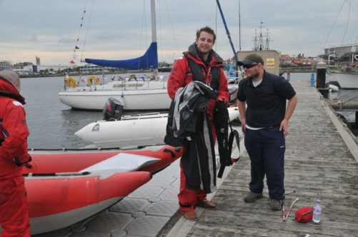 Tony on a jetty with Adam, preparing to ride in a Thundercat racing boat.