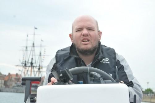 Closer view of Tony at the wheel.