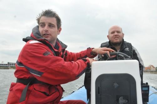 Adam helping Tony steer the boat.