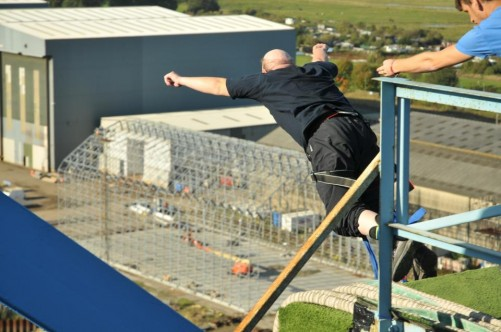 Tony jumping from a platform on the Transporter Bridge. The bungee cord is attached to his ankles.