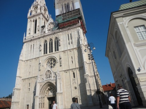 Outside the front of Zagreb's cathedral with its tall twin spires.