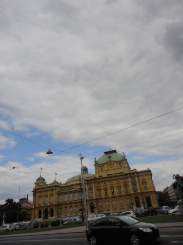 Looking across a road and tram line towards the Croatian National Theatre.
