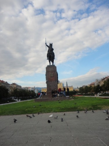 A large statue of King Tomislav (crowned 925) on horseback. Located in Tomislava square (or park) just north of the railway station. The large Art Pavilion building can be seen at the other end of the square.