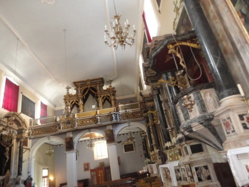 St Savior's Church looking away from the main altar. A balcony incorporating an organ at the back.