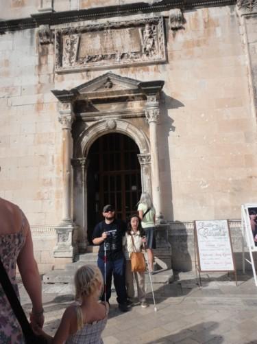 Tony and Tatiana outside the doorway of St Savior's Church.