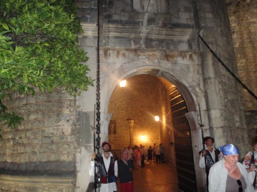 The exterior of Pile Gate. Ceremonial guards at either side of the doorway.