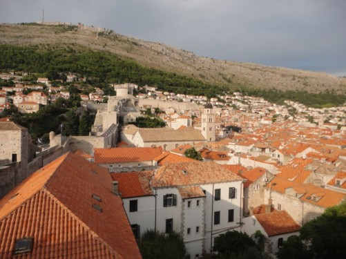 View over the old town. Various towers and other fortifications can be seen in the city walls. Also, Mount Srd in the background, standing at 412 metres in height.