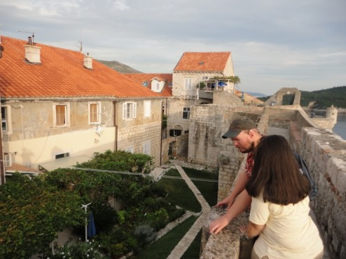 Tony and Tatiana looking down on a private garden from the walls above.