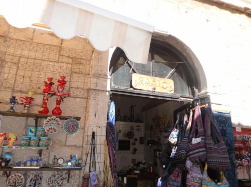 Outside a souvenir shop: a range of craft items for sale.