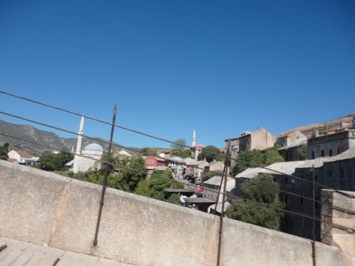 View of the Bosnian Muslim part of the town from the bridge. Two mosques with tall minarets visible.
