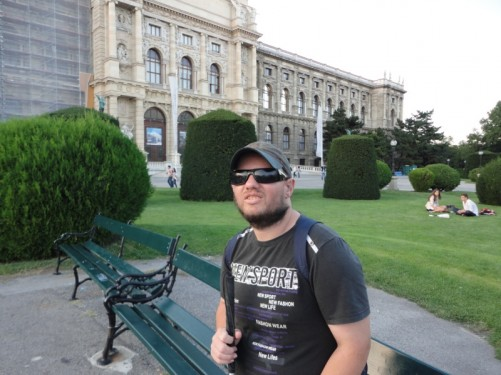 Tony sitting on a bench in Maria-Theresien-Platz. The Naturhistorisches Museum again in shot.
