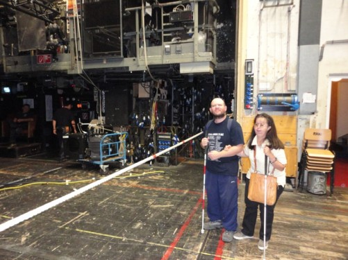 Tony, Tatiana in the backstage area. Assorted machinery in the background.