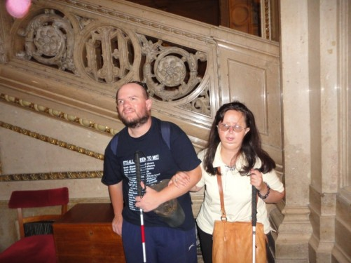 Tony and Tatiana by a decorative marble staircase in the Vienna State Opera.