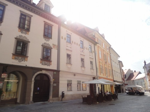 Pedestrian street off Town Square. It is lined with attractive Baroque style buildings.