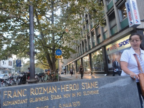 Tatiana on a central street by a marble monument dedicated to Franc Rozman – Stane (1911 - 1944).  He was a Slovenian partisan commander in World War II.