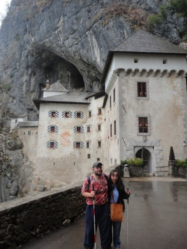Tony and Tatiana outside Predjama Castle.