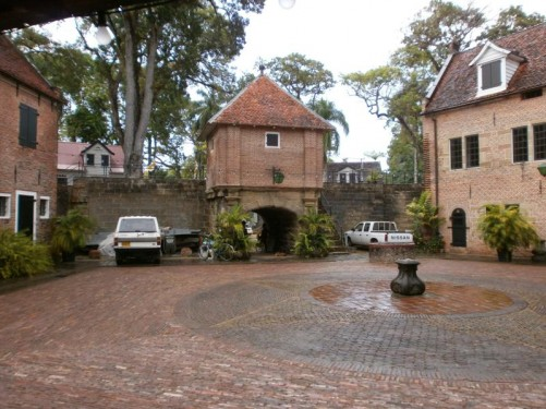 A courtyard in the centre of Fort Zeelandia, surrounded by buildings built mostly of brick.