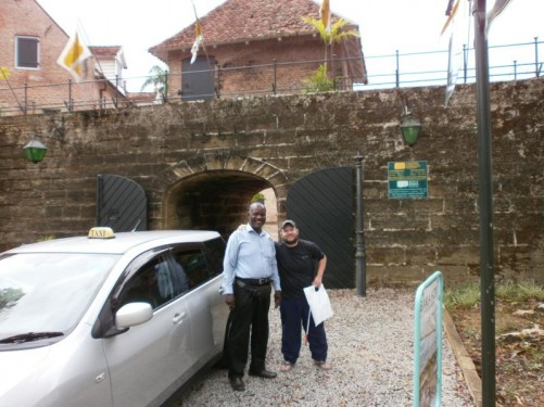 Tony outside the entrance to Fort Zeelandia with a taxi driver.