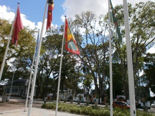 The flags of several countries flying at the side of Independence Square.