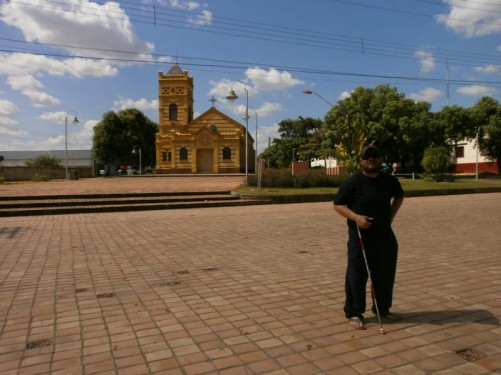 Tony standing in a square in front of the Church of Our Lady of Carmo. The church was constructed in 1909 replacing a small chapel built for Franciscan missionaries in 1892.