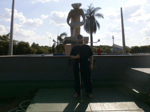 Statue of a gold prospector in the main square. Tony in front.