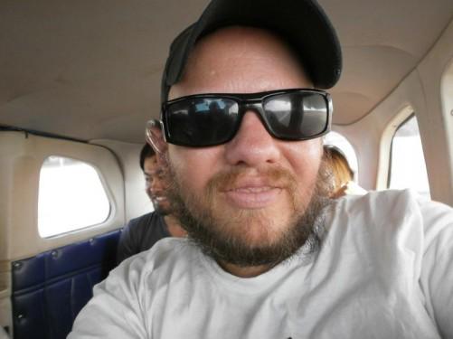 Tony inside a small plane flying to Canaima National Park from Ciudad Bolivar.