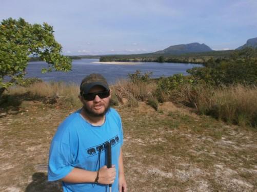 Tony on a grassy area above the lagoon.