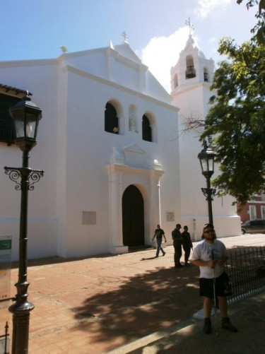 Tony outside Coro Cathedral. The white painted cathedral is located on Plaza Bolivar. Construction began in 1583 and it was completed approximately 50 years later. It is the oldest cathedral in Venezuela.