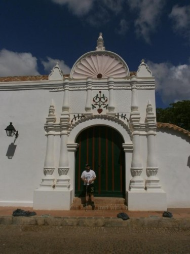 Tony in the doorway of the Casa de las Ventanas de Hierro (House of the Iron Windows). This mansion was built in the 17th century. It is so named because it was built with iron grills across the windows: they were imported from Andalusia and were unusual in Venezuela at that time.