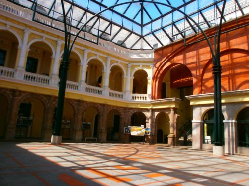 The glass-roofed courtyard of the Metropolitan Cultural Centre (Centro Cultural Metropolitano). This historic building has served various functions through its history, including being the Royal Lima Barracks in the 17th century and more recently the Central University.