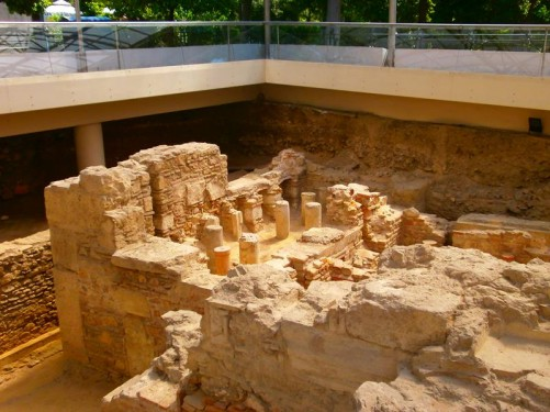 Looking down into excavated remains of a Roman bath complex. The remains were discovered during construction of an air shaft for Athen's metro system and they were opened to the public in 2003-4. Located on Amalias Avenue near the National Gardens and the Temple of Olympian Zeus.