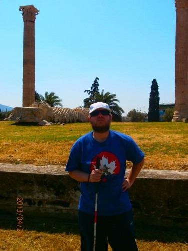 Tony in front of the pair of columns.