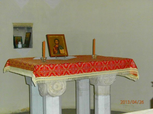 A simple altar on a stone table inside the church.
