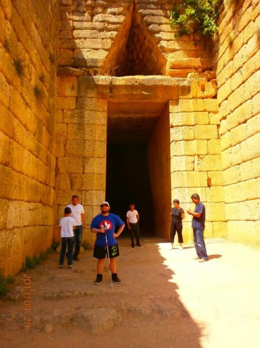 Tony outside a massive stone doorway leading inside the Tomb of Agamemnon.
