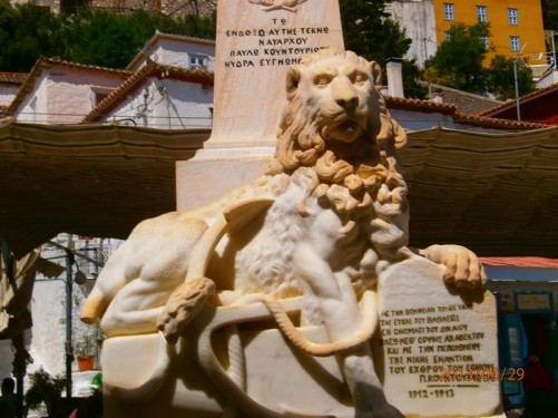 Close-up of the reclined lion and anchor at the base of the Pavlos Kountouriotis Monument.