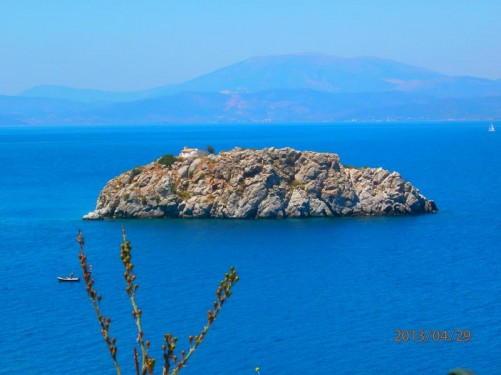 In the distance, the small island of Agios Ioannis, with a chapel just visible on top. It is situated near the coast, approximately two kilometres from Hydra's main harbour.