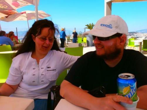 Tony and Tatiana sitting at an outdoor café on Lykavittos Hill.